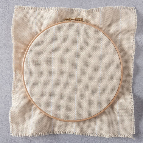 Punch needle fabric stretched in hoop