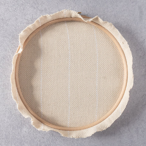 Monks cloth fabric stretched in hoop and trimmed around edge