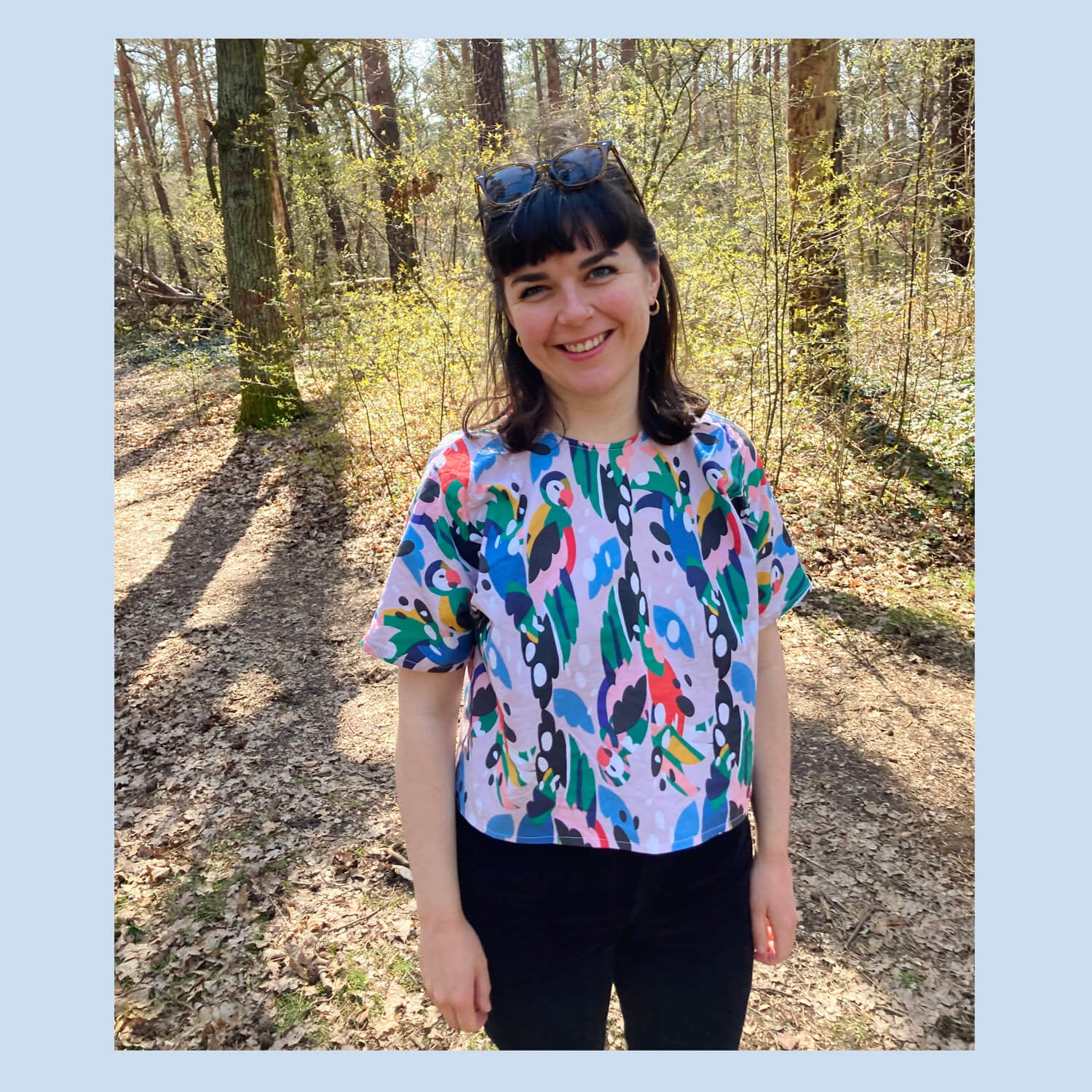 Alice wearing a handmade top in 'Find the Parrots' design