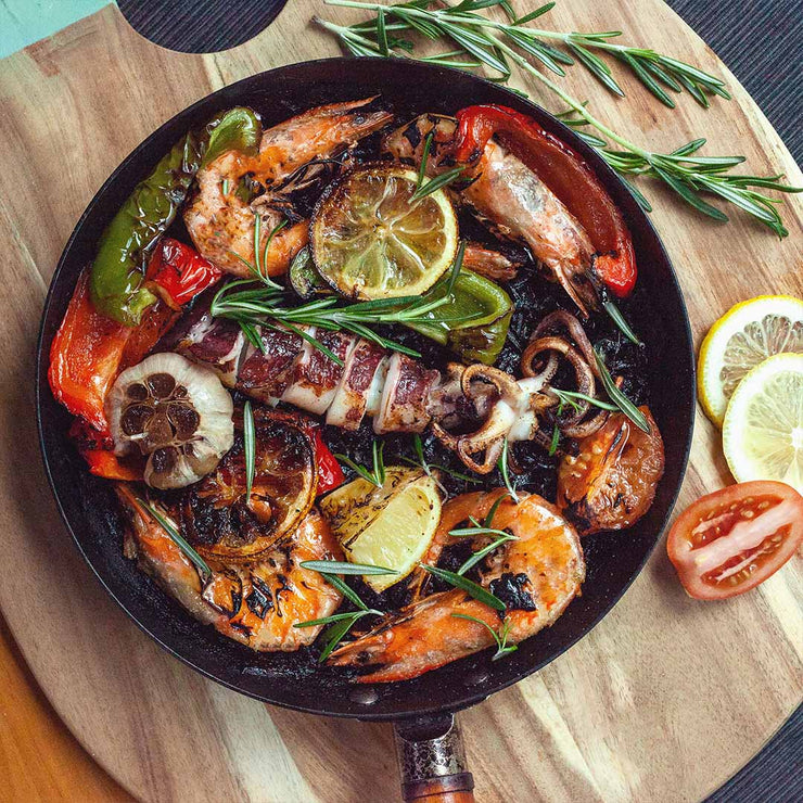 Fri, Aug 16 - Squid Ink Paella Topped with Grilled Tiger Prawns, Charred Squid and Roasted Bell Peppers By Joshua-Uriel Leong
