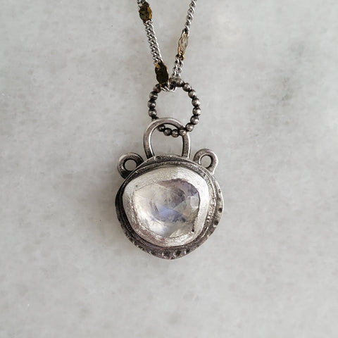 hollow-form moonstone pendant
