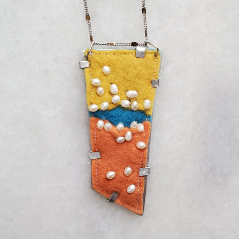 Easter egg inspired pendant made with felt scraps, pearls, and aluminum