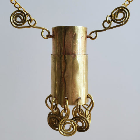 brass whistle pendant made from plastic whistle
