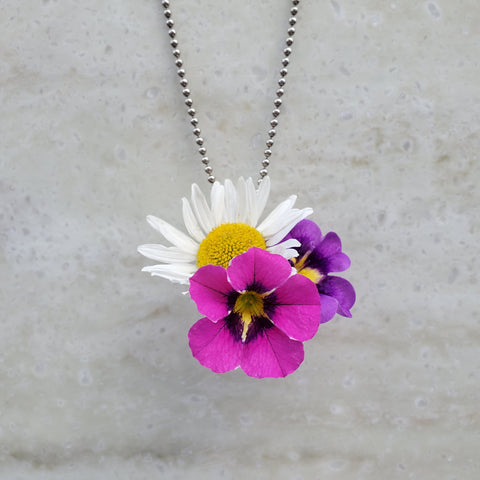 Flowers in flower holder pendant