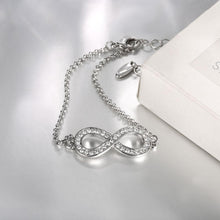 Load image into Gallery viewer, Infinity Pave Bracelet in 18k White Gold Plating