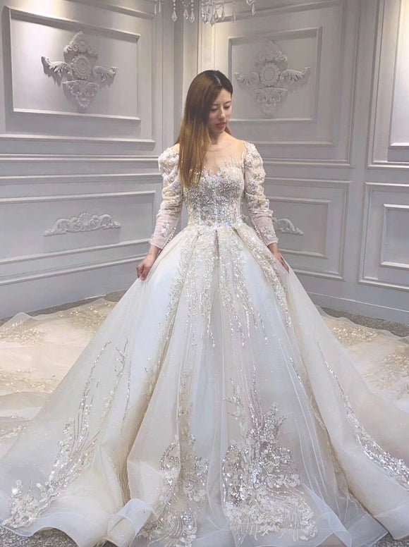 Long sleeves lace appliqués crystals pearls beaded champagne ball gown wedding dress