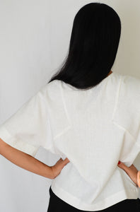 Back view of Kabuki Tee Sewing pattern worn by model