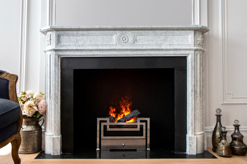 Anaya hand-carved marble fireplace mantel by Marmoso