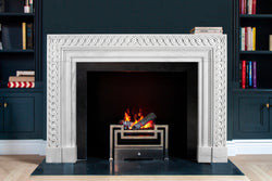 Eternelle hand-carved marble fireplace mantel by Marmoso