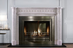 Langham hand-carved marble fireplace mantel by Marmoso