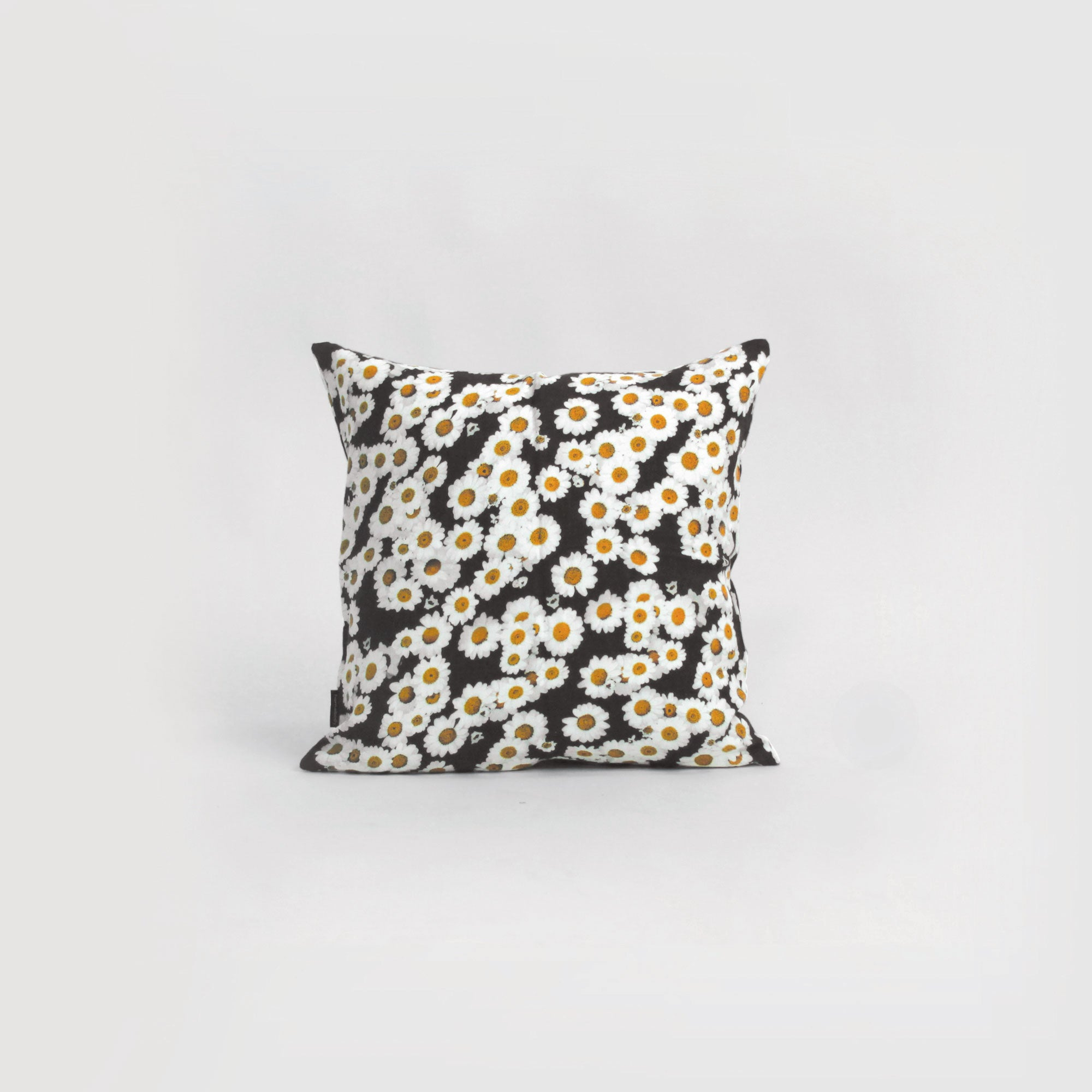 homebody daisy print linen cushion in black, white and mustard