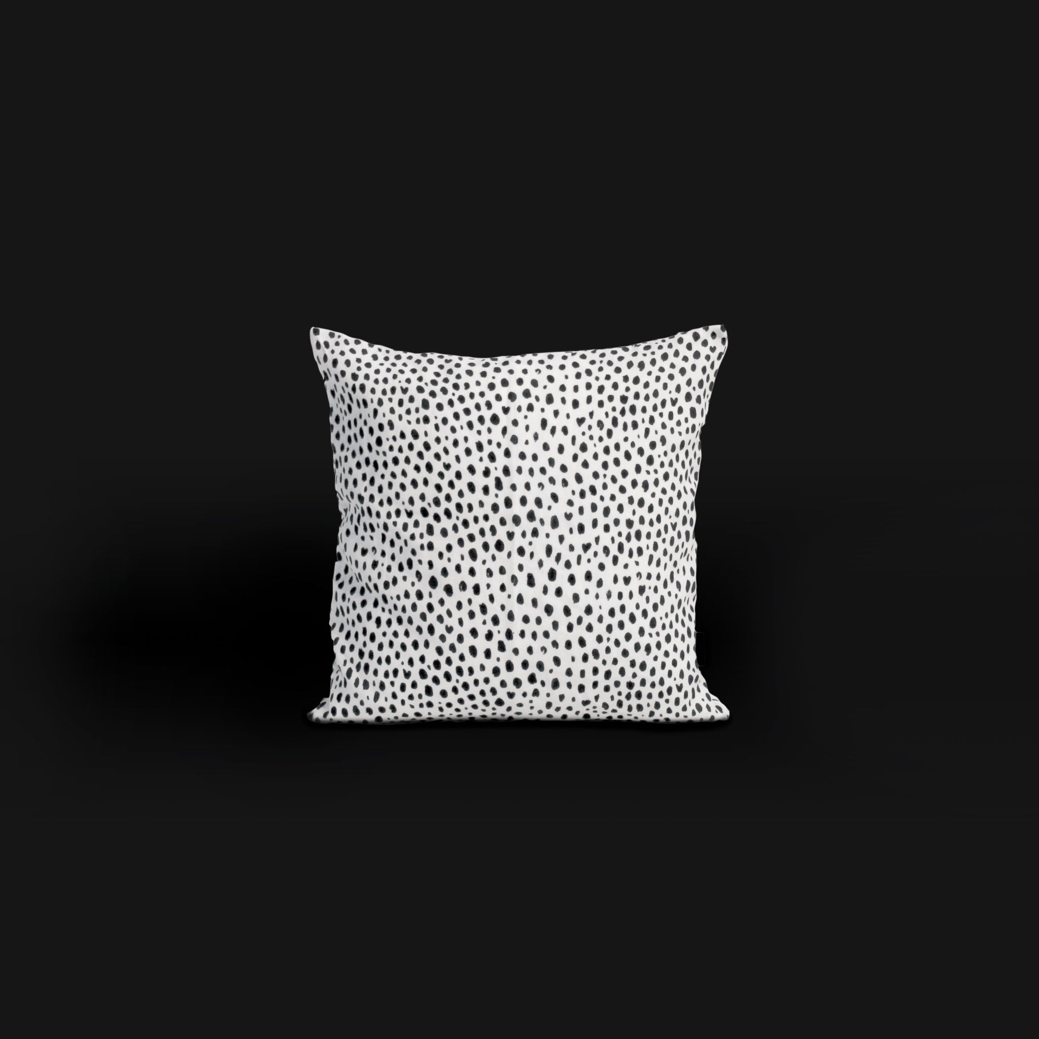 Black and white spot animal print cushion in 100% printed linen