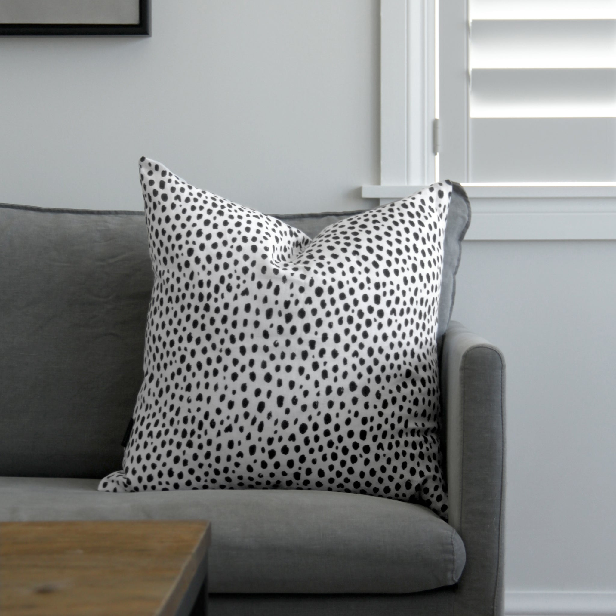 sofa styling with linen cushion in animal print