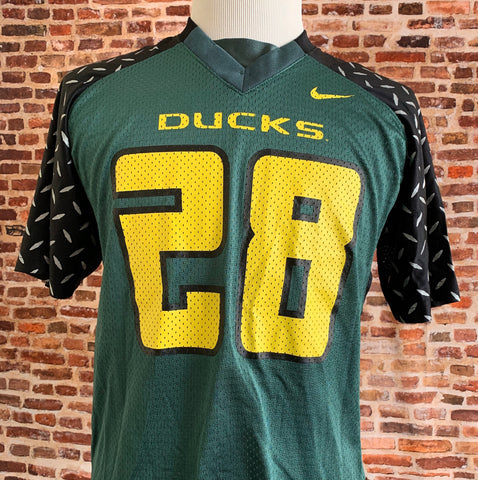 Vintage OREGON DUCKS Football Men's Small #28 Jersey RARE made by Nike