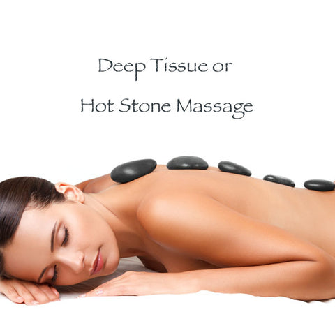 woman laying on stomach with massage stones on her back preparing for a relaxing massage.