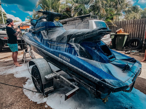 Blue Jetski covered with Salt Wash Snow Foaming Product in Drivewat