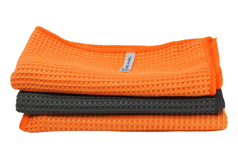 Three Stacked Orange and Grey Waffle Microfibre Towels