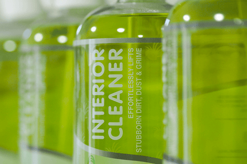 Row of green 500ml spray bottles filled with Interior Cleaner