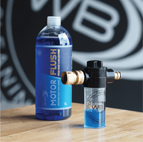 """Bottle of Blue Marine """"Motor Flush"""" with A Motor Flusher filled with the product in front of the Wat-er Blast Logo"""