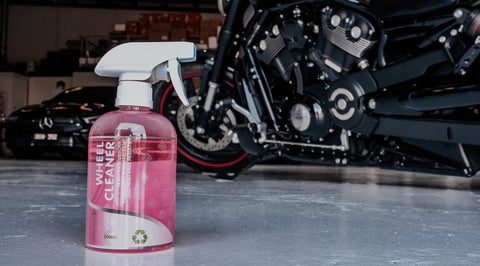 """Pink """"Wheel Cleaner"""" Spray Bottle in front of Harley Motorcycle"""