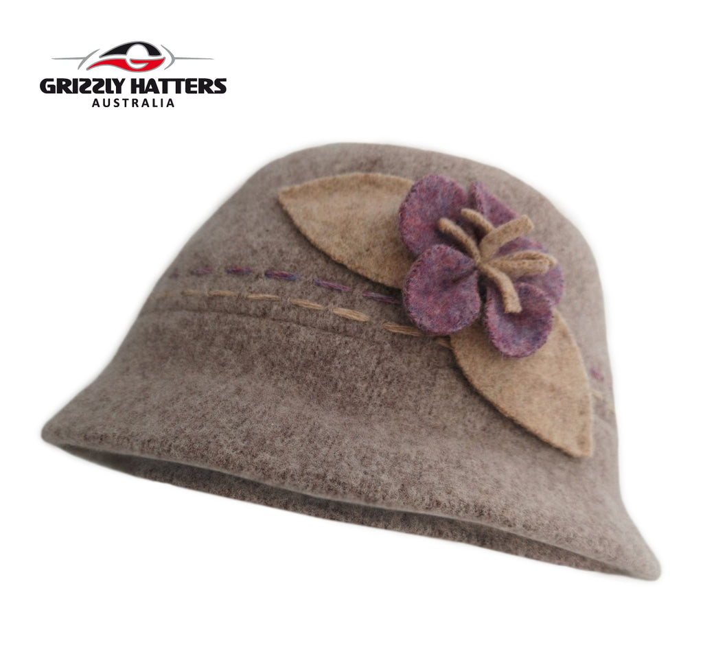Fashionable Ladies Foldable Wool Hat with curled up brim cream oatmeal colour with purple flower
