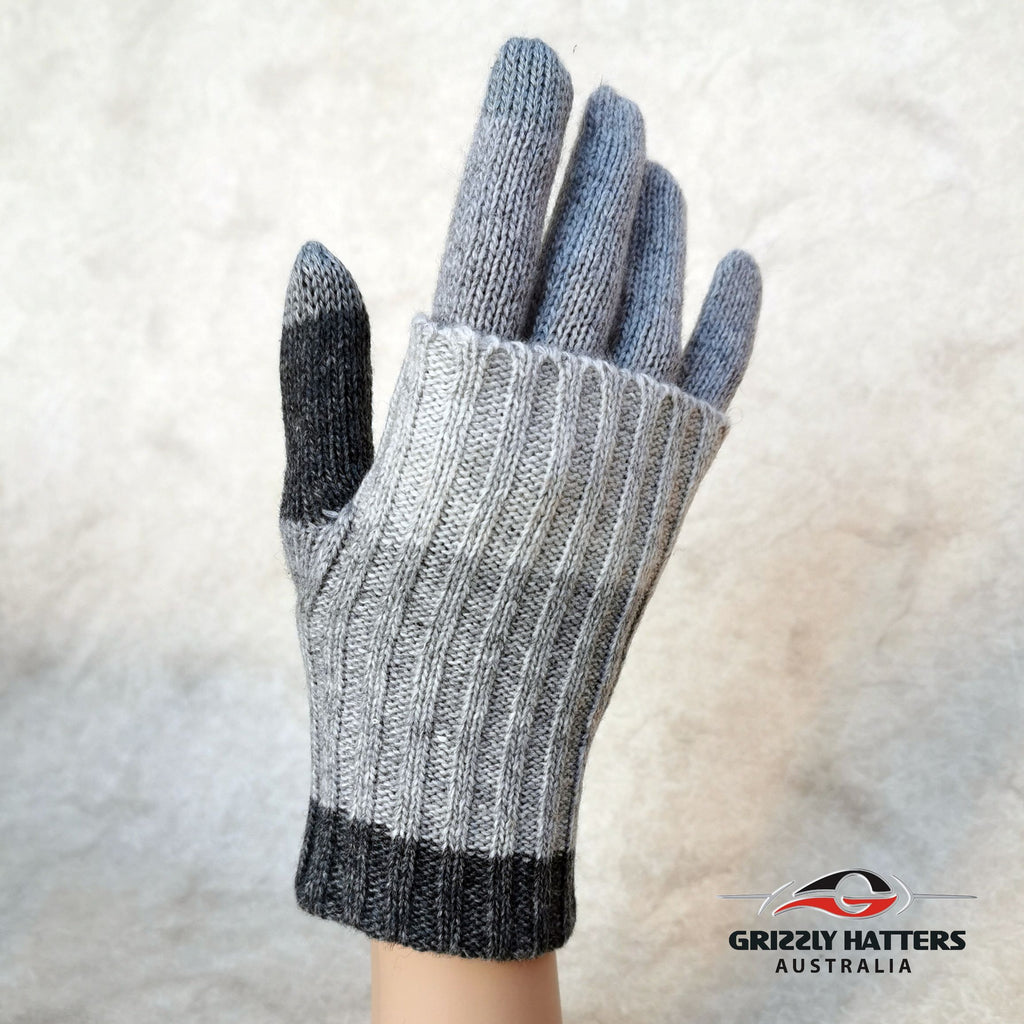 Merino wool touch-screen gloves with long rib cuff folded over hand with thumb hole