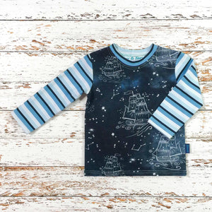 Sugar and Storm's Long Sleeve Tee made from beautifully soft organic cotton jersey. GOTS and EOKO-TEX certified. This pattern is called Sail on a dream with Storm Stripe. The pattern contains star constellations of tall ships and various twinkling stars on a misty navy-blue textured sky. The Sleeves and Neck band are the Storm Stripe pattern.