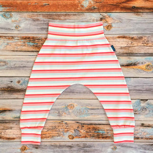 Sugar and Storm's Harem Pants made from beautifully soft organic cotton jersey. GOTS and EOKO-TEX certified. This is Sugar and Storms signature Sugar Stripe. It contains four colour stripes – red, Baby pink, pale blue, and white.