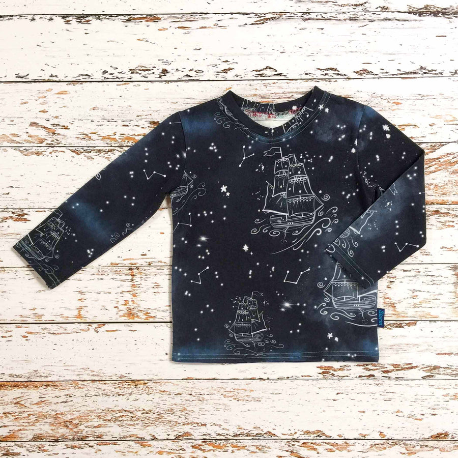 Sugar and Storm's Long Sleeve Tee made from beautifully soft organic cotton jersey. GOTS and EOKO-TEX certified. This pattern is called Sail on a dream. The pattern contains star constellations of tall ships and various twinkling stars on a misty navy-blue textured sky.