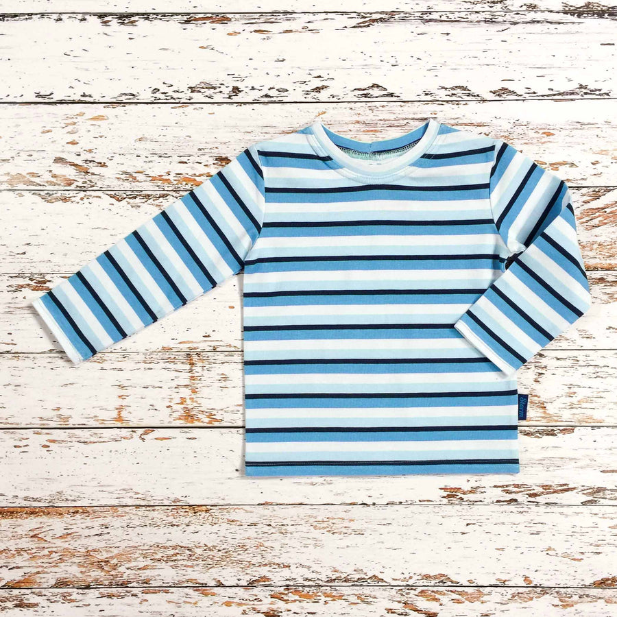 certified. This is Sugar and Storm's Long Sleeve Tee made from beautifully soft organic cotton jersey. GOTS and EOKO-TEX Sugar and Storms signature Storm Stripe. It contains four colour stripes – navy, sea blue, pale blue, and white.