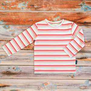 Sugar and Storm's Long Sleeve Tee made from beautifully soft organic cotton jersey. GOTS and EOKO-TEX certified. This is Sugar and Storms signature Sugar Stripe. It contains four colour stripes – red, Baby pink, pale blue, and white.