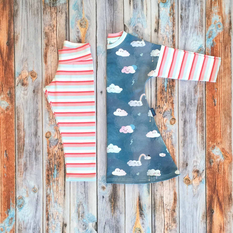 Sugar and Storm's Dress and Leggings Bundle Option 2 made from beautifully soft organic cotton jersey. GOTS and EOKO-TEX certified. This bundle includes one Long Sleeve Dress with Head in the Clouds and Sugar Stripe pattern and one relaxed fit Leggings with Sugar Stripe pattern.