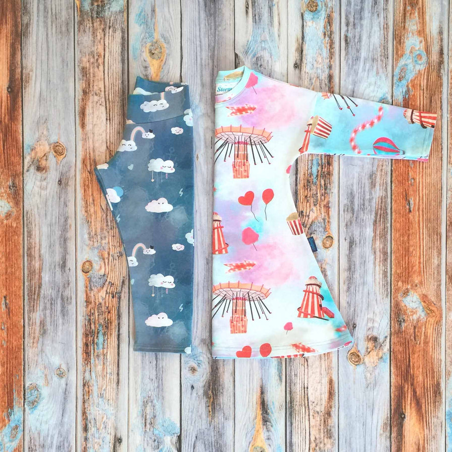 Sugar and Storm's Dress and Leggings Bundle Option 2 made from beautifully soft organic cotton jersey. GOTS and EOKO-TEX certified. This bundle includes one Long Sleeve Dress with Sugar Rush! pattern and one relaxed fit Leggings with Head in the Clouds Pattern.