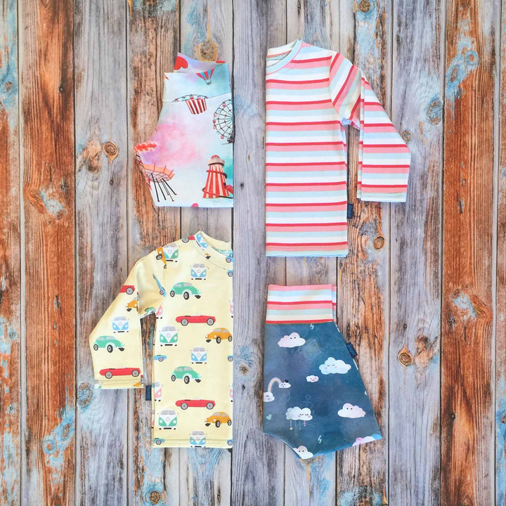Sugar and Storm's Mix 'n' Match Bundle Option 1 made from beautifully soft organic cotton jersey. GOTS and EOKO-TEX certified. This bundle includes two Long Sleeve Tees in Memory Lane pattern and Sugar Stripe pattern, one relaxed fit Leggings with Sugar Rush! Pattern, and one Harem Pants with Head in the Clouds with Sugar Stripe pattern.