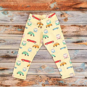 Sugar and Storm's relaxed fit Leggings made from beautifully soft organic cotton jersey. GOTS and EOKO-TEX certified. This retro pattern is called Memory Lane. The patter contains a variety of vintage cars and camper vans of different candy colours on a pale-yellow background.