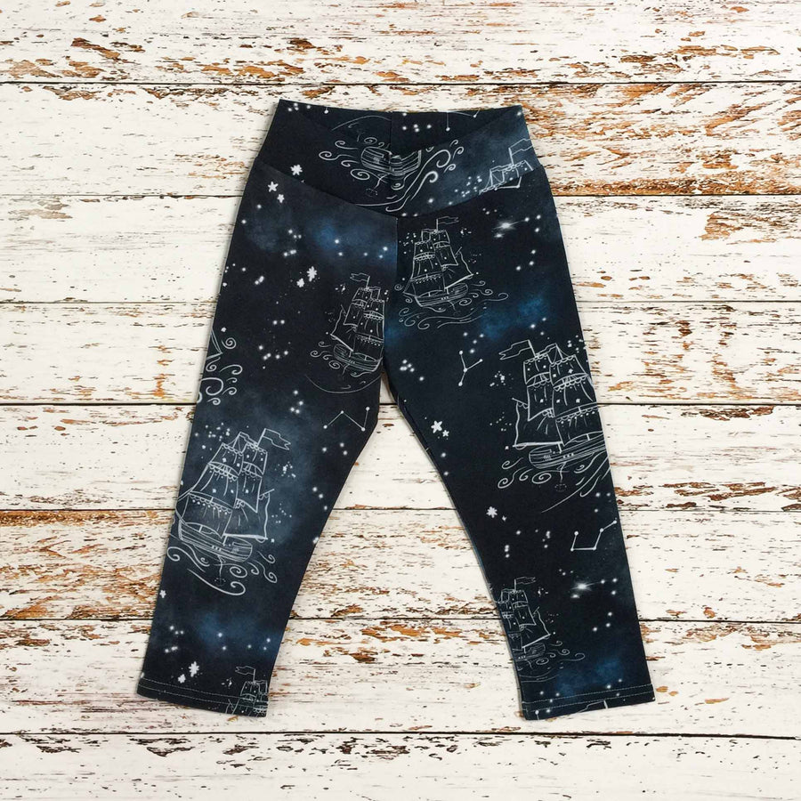 Sugar and Storm's relaxed fit Leggings made from beautifully soft organic cotton jersey. GOTS and EOKO-TEX certified. This pattern is called Sail on a dream. The pattern contains star constellations of tall ships and various twinkling stars on a misty navy-blue textured sky.