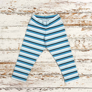 This is Sugar and Storm's relaxed fit Leggings made from beautifully soft organic cotton jersey. GOTS and EOKO-TEX Sugar and Storms signature Storm Stripe. It contains four colour stripes – navy, sea blue, pale blue, and white.