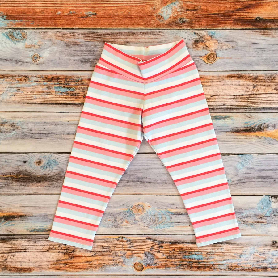 Sugar and Storm's relaxed fit Leggings made from beautifully soft organic cotton jersey. GOTS and EOKO-TEX certified. This is Sugar and Storms signature Sugar Stripe. It contains four colour stripes – red, Baby pink, pale blue, and white.