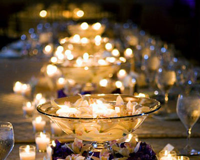 Submerged candle centerpiece at wedding