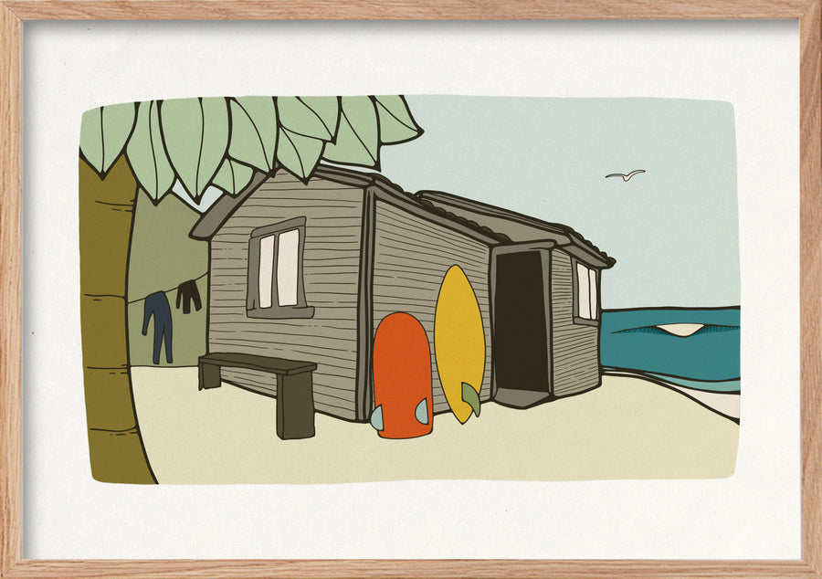 Surf shack beach house by the sea with waves wetsuits and surfboards