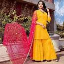 yellow kurta-sharara set with pink net dupatta