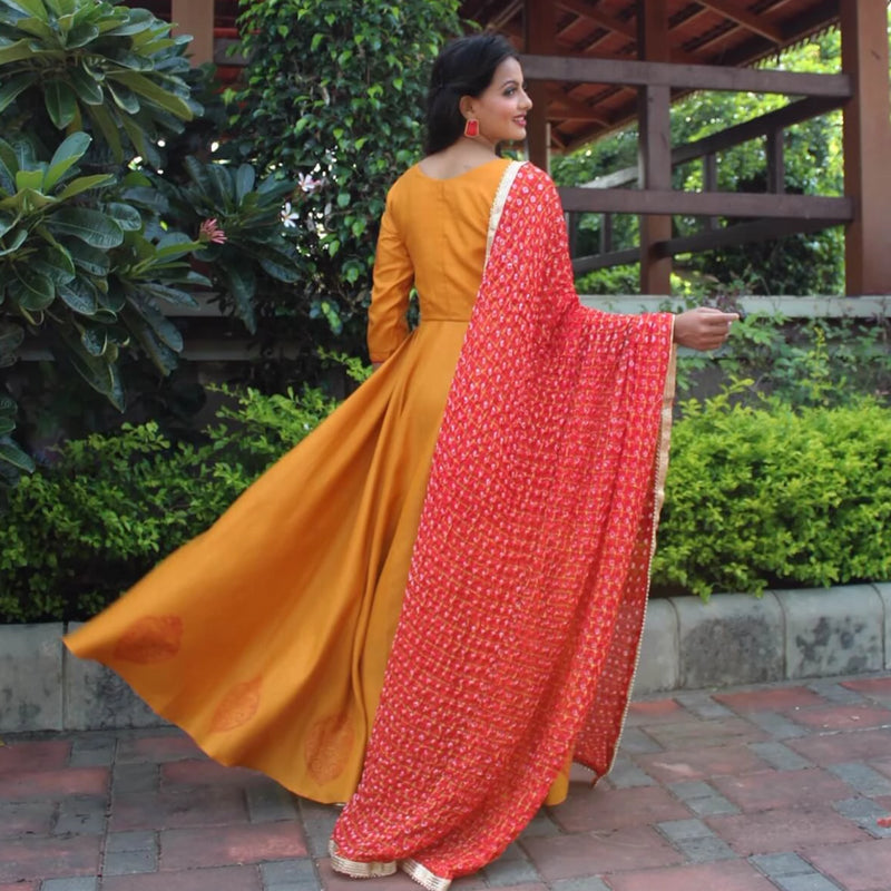 mustard yellow gown with bandhani dupatta