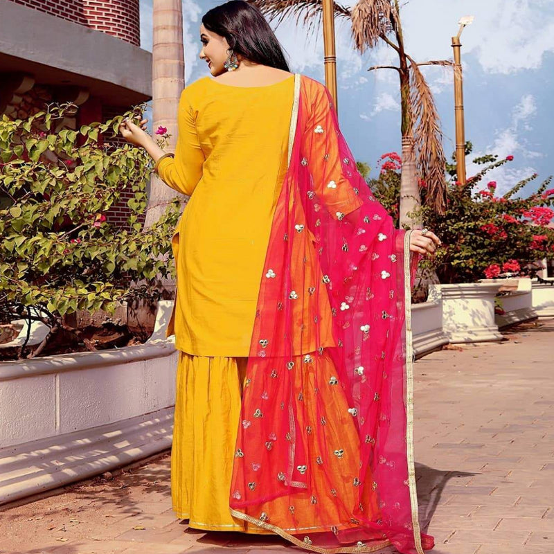 Yellow sharara with pink dupatta with mirror work on dupatta