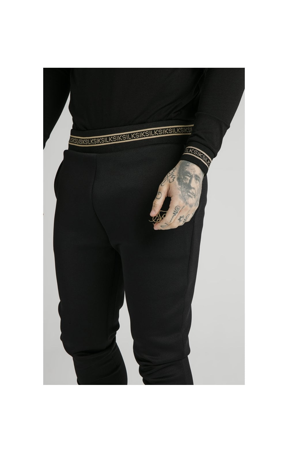 Load image into Gallery viewer, SikSilk Element Muscle Fit Cuff Joggers– Black & Gold (1)