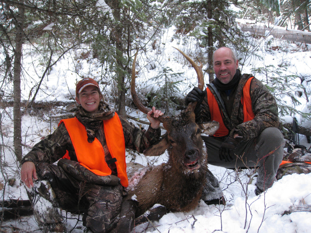 Bull Elk with happy Husband and Wife