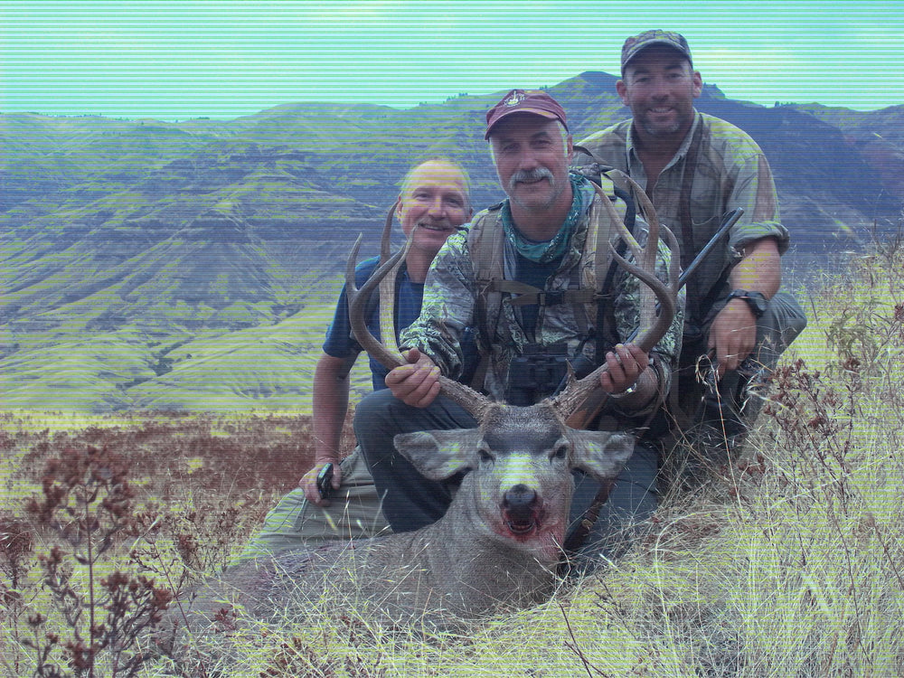 Mule Deer down by Orion back pack user