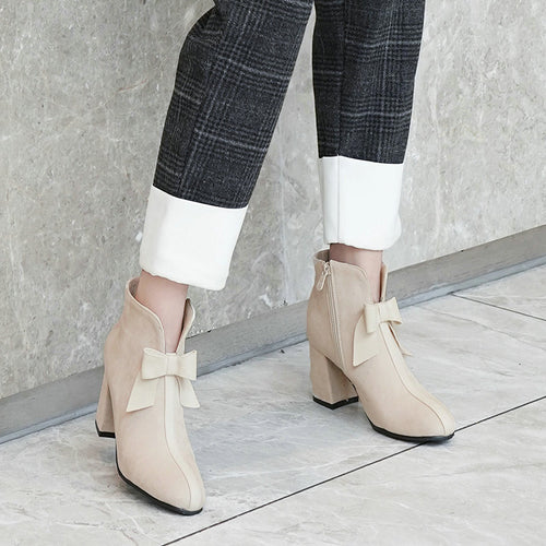 Faux Leather Heeled Ankle Bootie With Bow