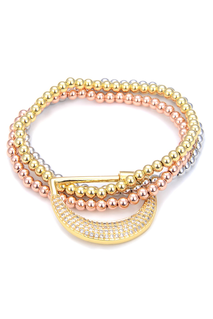 3 piece beaded bracelet set. Each bracelet is gold, rose gold or silver in color. Bracelets stacked together with crescent moon lock.