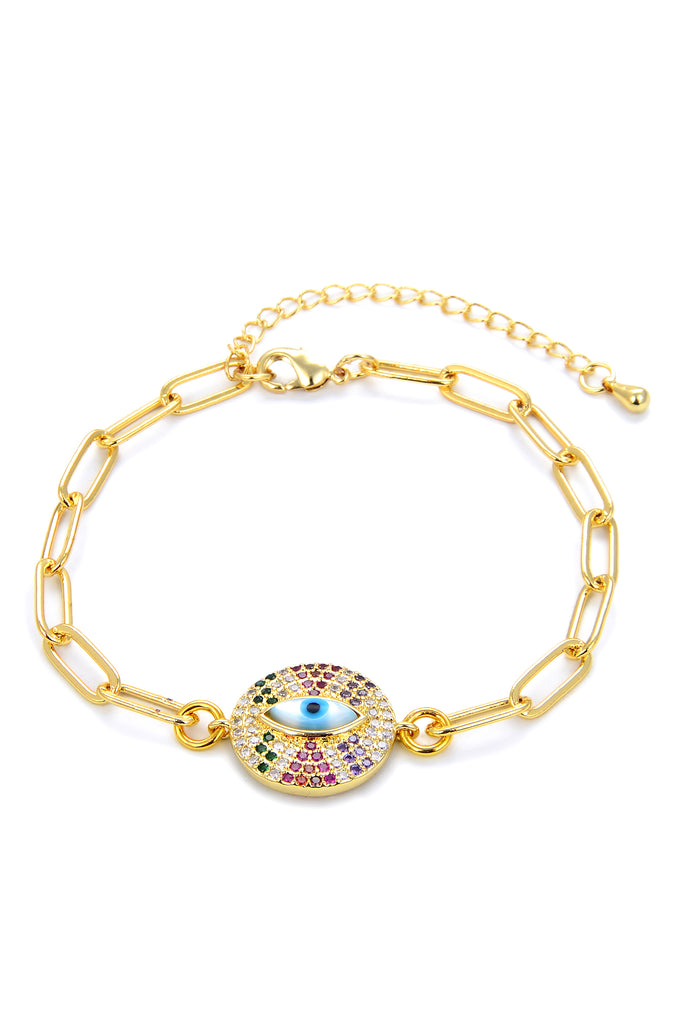 Gold chain link bracelet with shiny cubic zirconia studded circle charm with centered evil eye motif.
