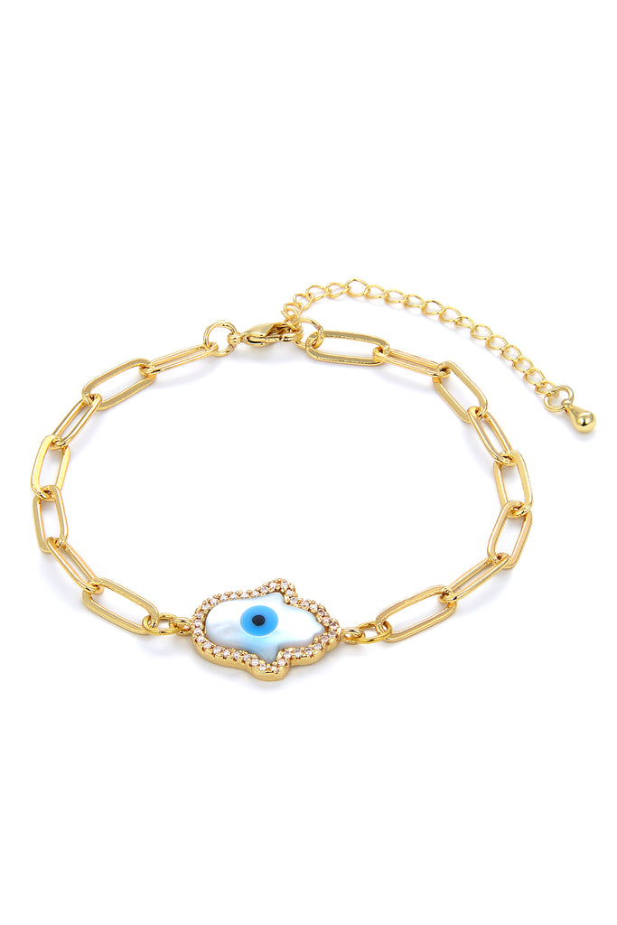 Chain charm bracelet with hamsa hand pendant and blue evil eye motif.